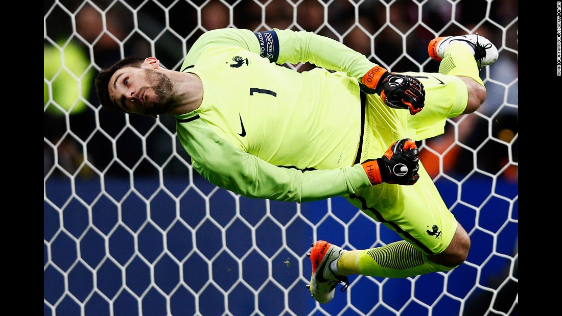 "French goalkeeper Hugo Lloris dives for a shot but can't make the save during a friendly match against Russia on Tuesday, March 29. It was France's <a href=""http://www.cnn.com/2016/03/29/football/gallery/football-brussels-paris-portugal/index.html"" target=""_blank"">first match at the Stade de France</a> since the Paris terror attacks in November."