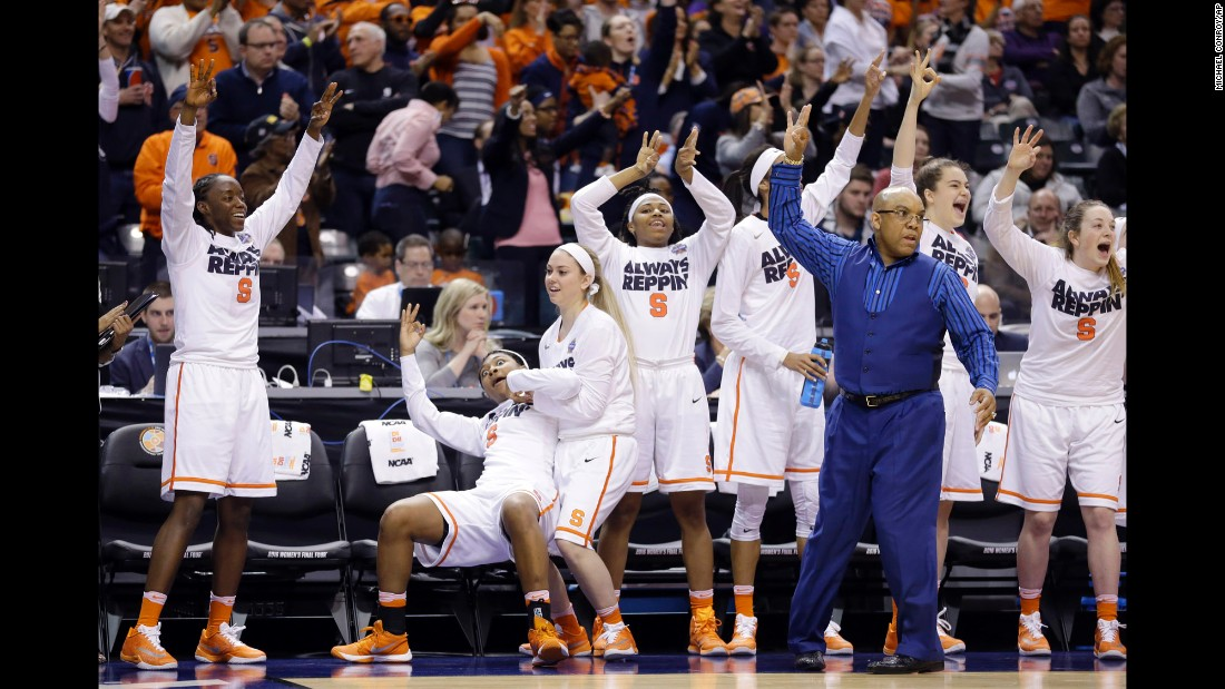 Syracuse's bench reacts to a 3-pointer during the team's Final Four win on Sunday, April 3. The Orange defeated Washington 80-59 to advance to the championship game.