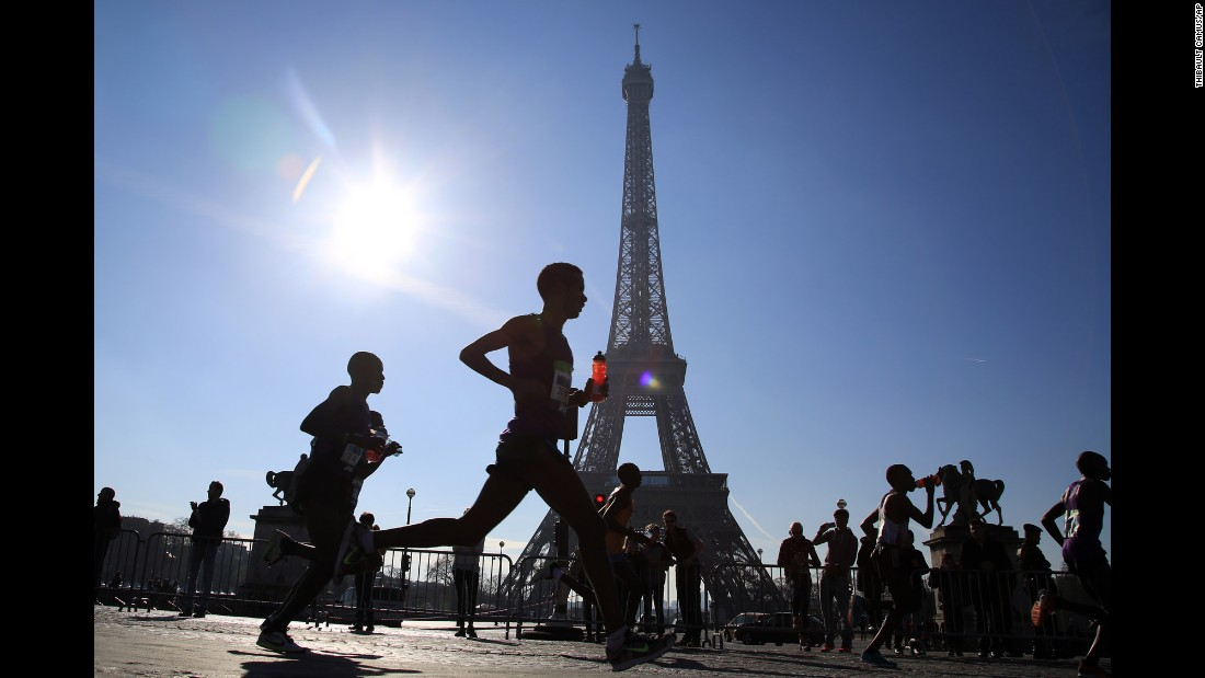 Runners participate in the Paris Marathon on Sunday, April 3.