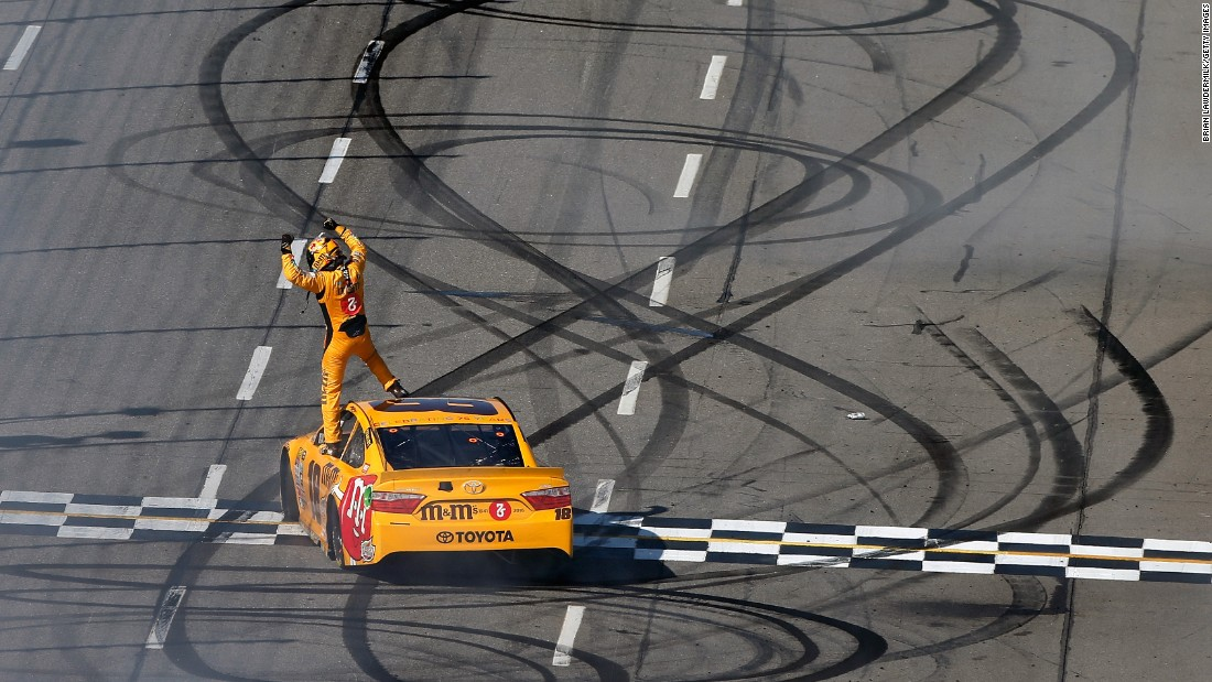 NASCAR driver Kyle Busch celebrates on top of his car after winning the Sprint Cup race in Martinsville, Virginia, on Sunday, April 3. It was the first victory of the season for Busch, who won the Sprint Cup title in 2015.