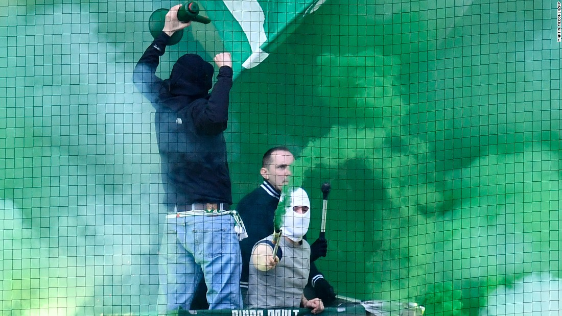 Fans of Werder Bremen support their soccer club during a German league match at Borussia Dortmund on Saturday, April 2.