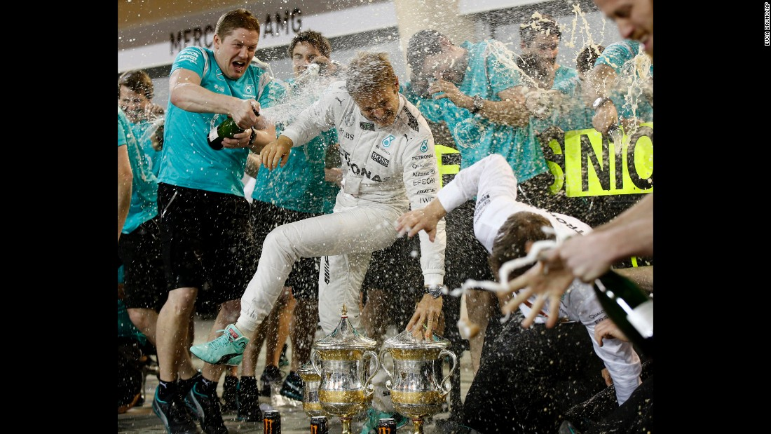 Formula One driver Nico Rosberg is sprayed by members of his team after winning the Bahrain Grand Prix on Sunday, April 3. Rosberg has won both of this season's F1 races.