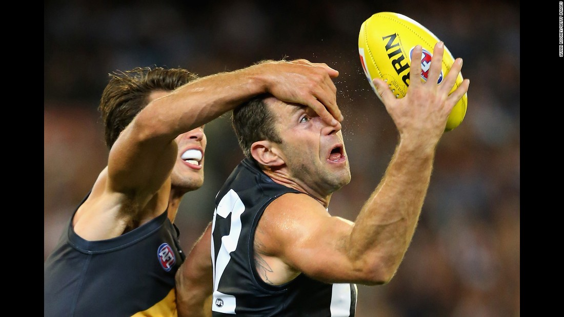 Travis Cloke of the Collingwood Magpies has his vision obscured by Alex Rance of the Richmond Tigers during an Australian Football League match in Melbourne on Friday, April 1.