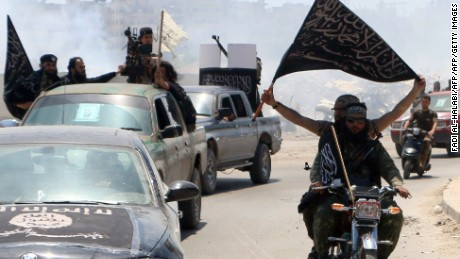 Fighters from al Qaeda's Syrian affiliate, al Nusra Front, drive in the northern Syrian city of Aleppo flying Islamist flags.