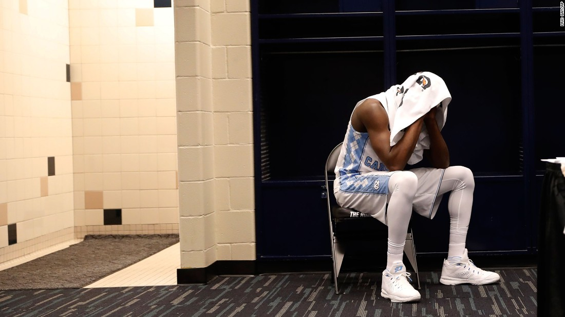 North Carolina's Theo Pinson sits in the locker room after the loss.