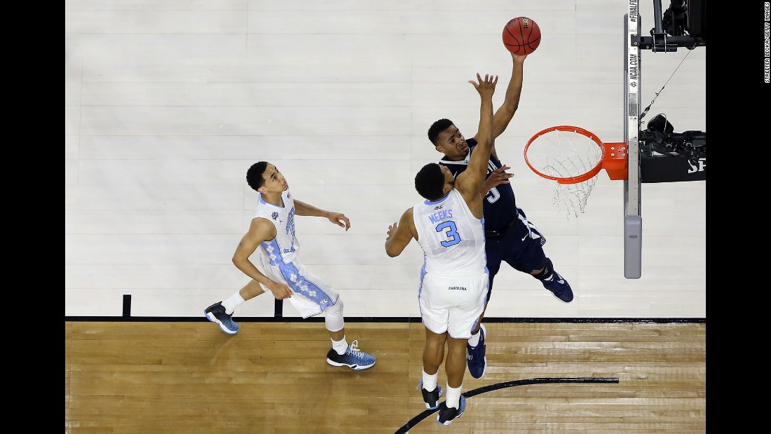 Villanova's Phil Booth shoots over Kennedy Meeks.