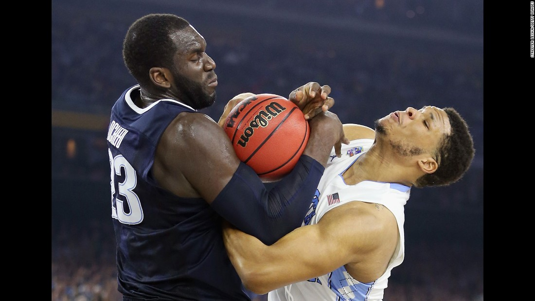 Meeks and Daniel Ochefu wrestle for the ball.