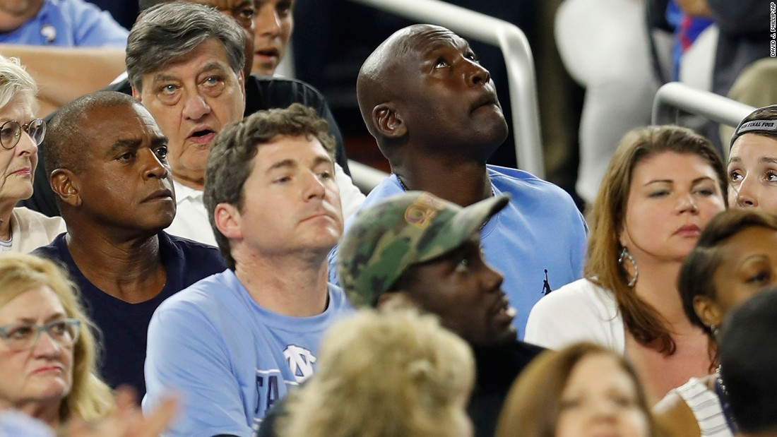 NBA legend Michael Jordan, who played for North Carolina, looks up at the scoreboard during the game.