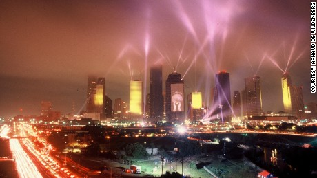 Spotlights illuminate the Houston skyline during Jean-Michel Jarre's April 1986 concert.