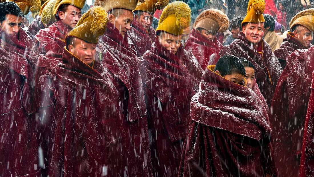 Longxiang Xie was shortlisted in the open contest for this photograph of Tibetan monks at the Langmu Temple in Gansu Province, during a heavy snowfall.