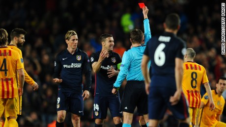 Torres is shown the red card by referee Felix Brych after a second rash challenge.