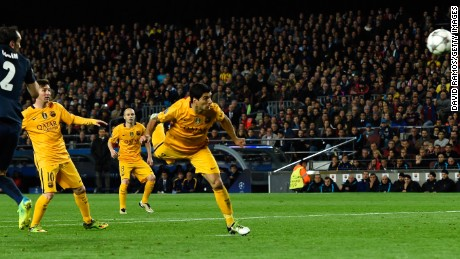 Suarez heads home his second and Barcelona's second in the 2-1 win over Atletico Madrid.