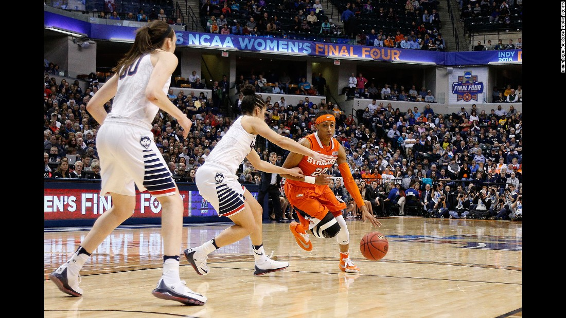 Syracuse guard Brittney Sykes dribbles the ball as Connecticut guard Kia Nurse, center, defends.
