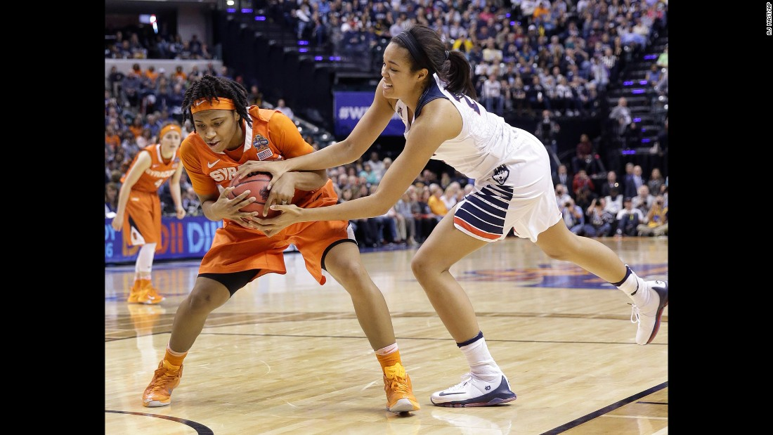 Syracuse's Cornelia Fondren and Connecticut's Napheesa Collier battle for the ball.