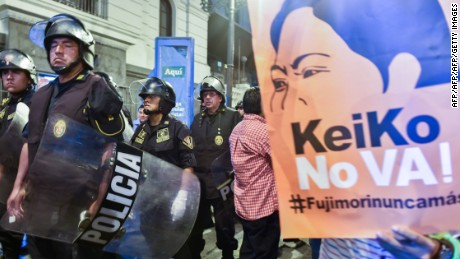 Activists against the presidential candidacy of Keiko Fujimori, daughter of imprisoned former president Alberto Fujimori (1990 to 2000), rally in Lima April 05, 2016, five days prior to the presidential elections for which Fujimori leads the voting intention polls with over 34 percent of the voting intention.   / AFP / CRIS BOURONCLE        (Photo credit should read CRIS BOURONCLE/AFP/Getty Images)