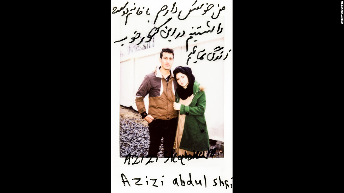 "Azizi Shabnan and Azizi Abdul Shahi pose together. The translation: ""I would like to live my life with this lovely woman in this nice country."""