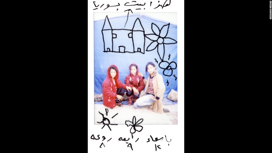 "There are drawings on this Polaroid of Asmaa, 12; Rabea, 9; and Raoah, 8. ""This is our house in Syria,"" it says on top."