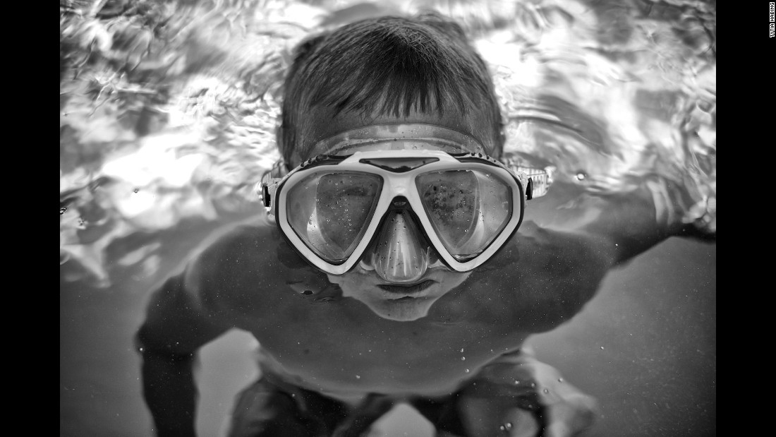 Tharin wears his goggles in the pool.