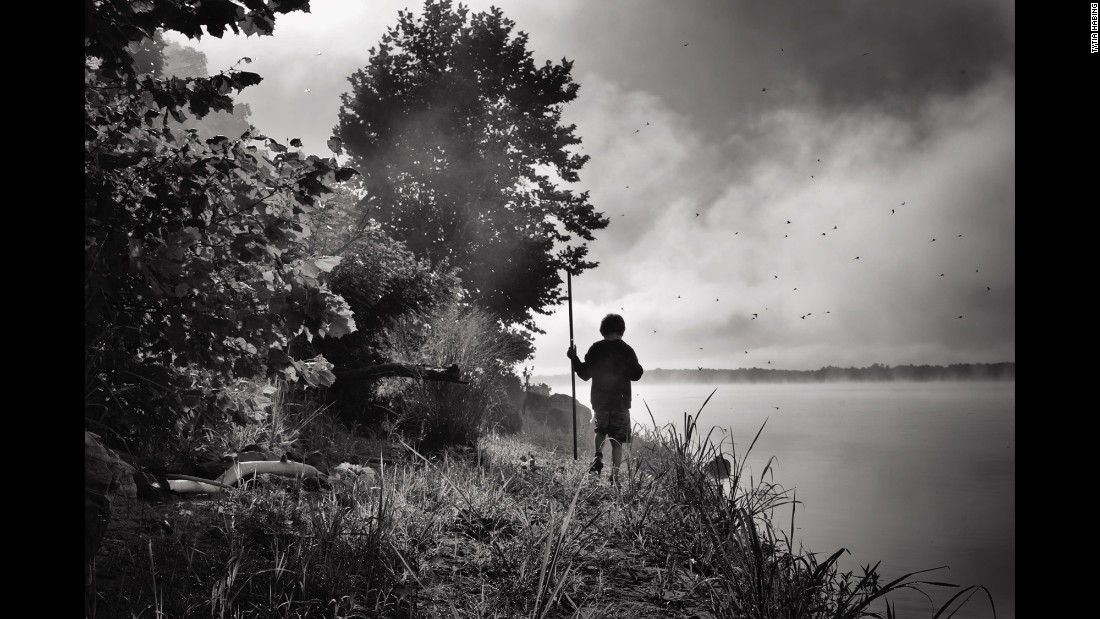 """Tharin plays near the Ohio River. """"I just let him do his own thing,"""" she said."""