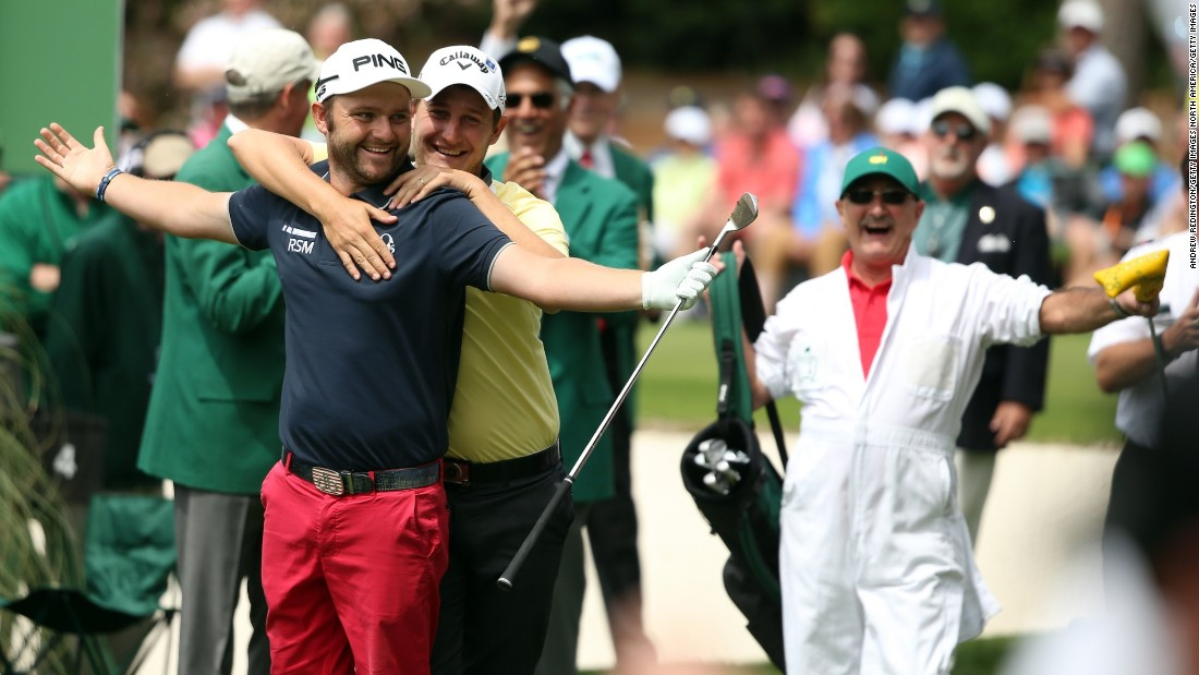 Englishman Andy Sullivan gets a warm Argentinian embrace from Emiliano Grillo after hitting a hole-in-one on the fourth hole.