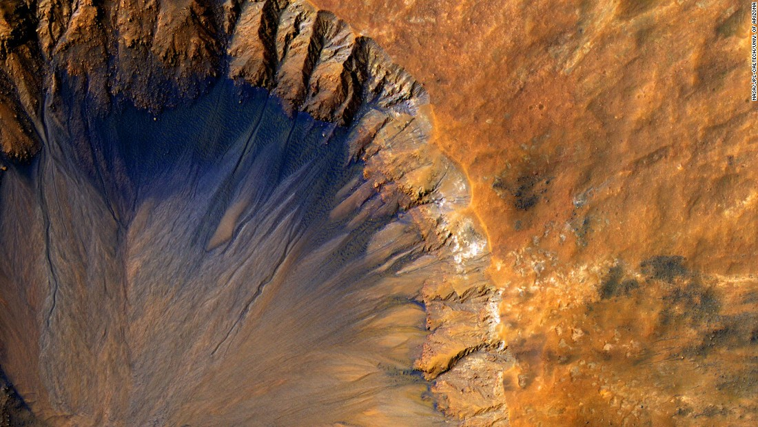 A crater on Mars, estimated to be about 1 kilometer wide.