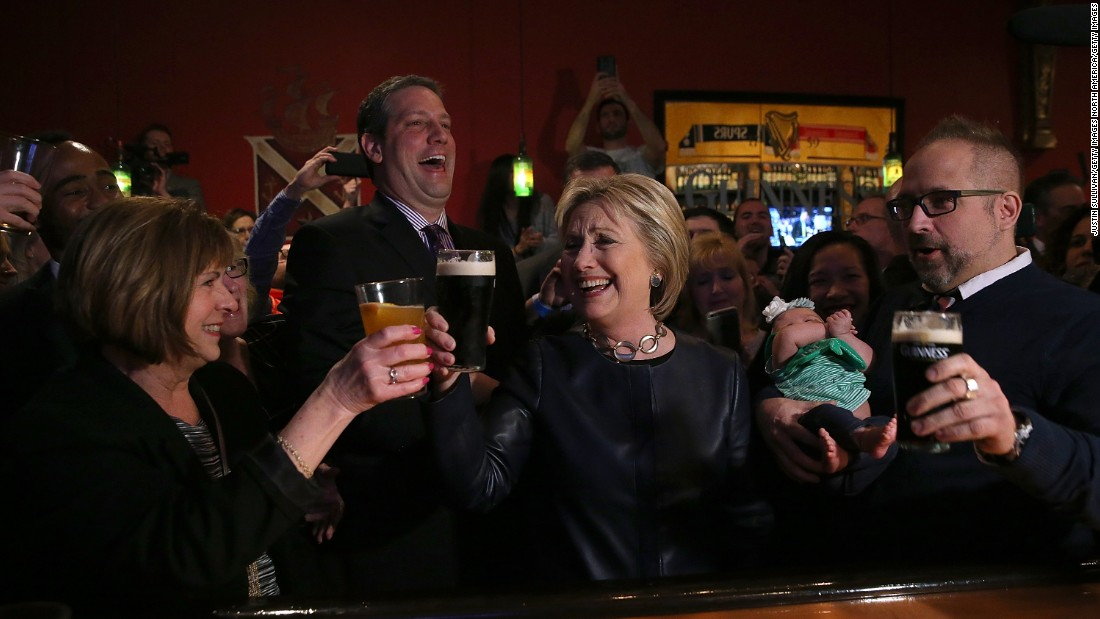 Democratic presidential candidate Hillary Clinton, center, has a pint of Guinness beer at a pub in Youngstown, Ohio, on March 12.
