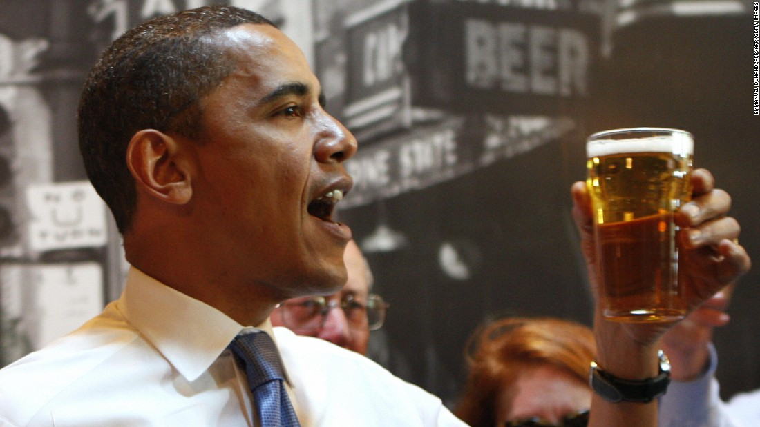 While campaigning for the presidency in May 2008, Obama offers a toast while meeting with residents in Raleigh, North Carolina.