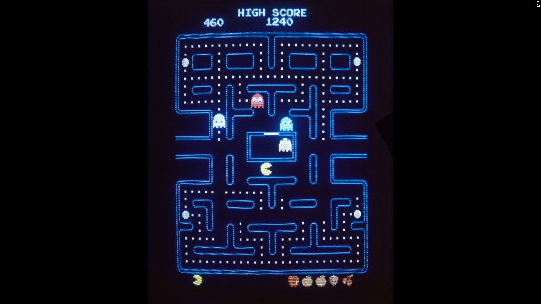 "<strong>'Pac-Man' fever takes hold:</strong> The video game ""Pac-Man"" -- featuring a hungry protagonist that must evade ghosts on his quest to eat tiny, white dots -- hit American arcades in October 1980 and became almost an instant success. Parent company Bandai Namco Entertainment sold more than <a href=""http://www.cnn.com/2010/TECH/05/21/pac-man.game.anniversary/"" target=""_blank"">100,000 arcade units</a> within 15 months. Its first name, ""Puck-man,"" came from the Japanese ""paku,"" or ""to chomp."""