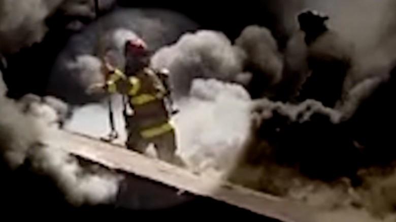 Firefighter falls through burning roof elam pkg_00000000
