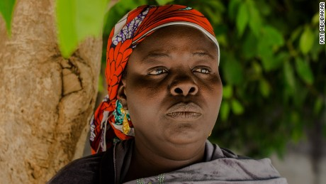 """""""The things Boko Haram has done to us in Bama, if I speak about it, it will take all day. When the terrorist came to our town, they killed the men, married half of the women and locked us in our houses. They searched thoroughly for men they thought we were hiding. They didn't want men alive. When some of us refused to marry them, they starved us and refused us water. We would sneak out at 3 am to fetch water. And we ate raw maize. We didn't have any money. We really suffered. Because the insurgents lived in our houses for 20 days using all of our stuff. But some of us survived and walked to Maiduguri. A lot of the women are sick, our husbands can't find jobs, the children are out of school. The schools here think some of them are too old and we don't have money for uniforms.""""  Anonymous"""