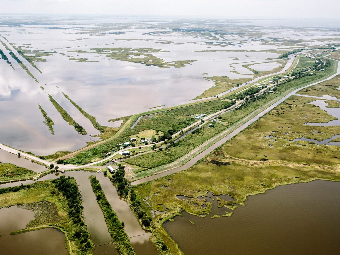 The community of Isle de Jean Charles, Louisiana, shown here in 2015, is disappearing in part because of poor river management and climate change.