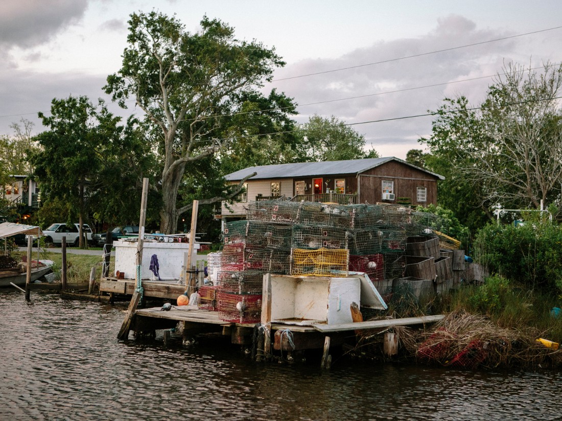 Crab traps are stacked on a dock on Bayou Pointe-aux-Chenes, which is near Isle de Jean Charles.