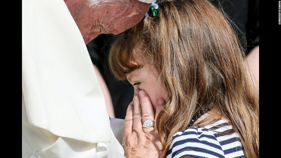 "Pope Francis meets with Lizzy Myers at the Vatican on Wednesday, April 6. The girl <a href=""http://www.cnn.com/2015/08/12/health/visual-bucket-list/"" target=""_blank"">is gradually losing her sight and hearing</a> because of a rare genetic disease."