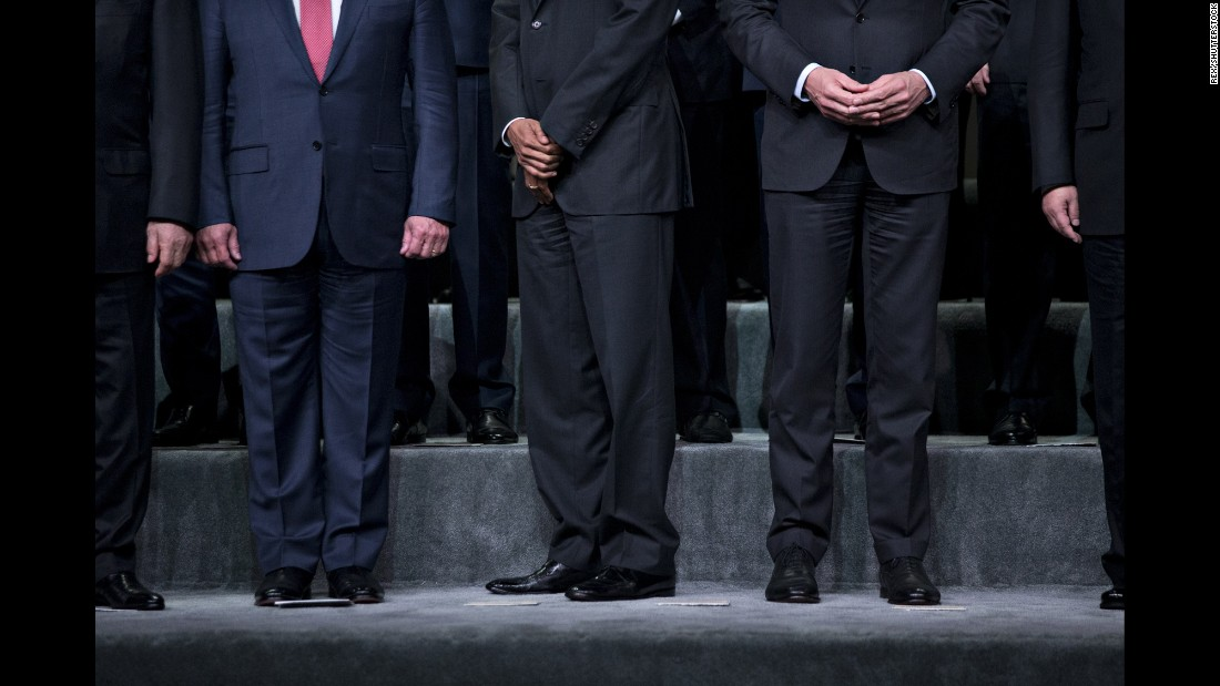 U.S. President Barack Obama, center, is flanked by Jordan's King Abdullah, left, and Dutch Prime Minister Mark Rutte during a group photo at the Nuclear Security Summit on Friday, April 1. The summit was held in Washington.