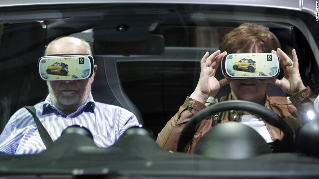 A woman in Berlin holds virtual-reality 3-D glasses before a shareholders meeting for automaker Daimler AG on Wednesday, April 6.
