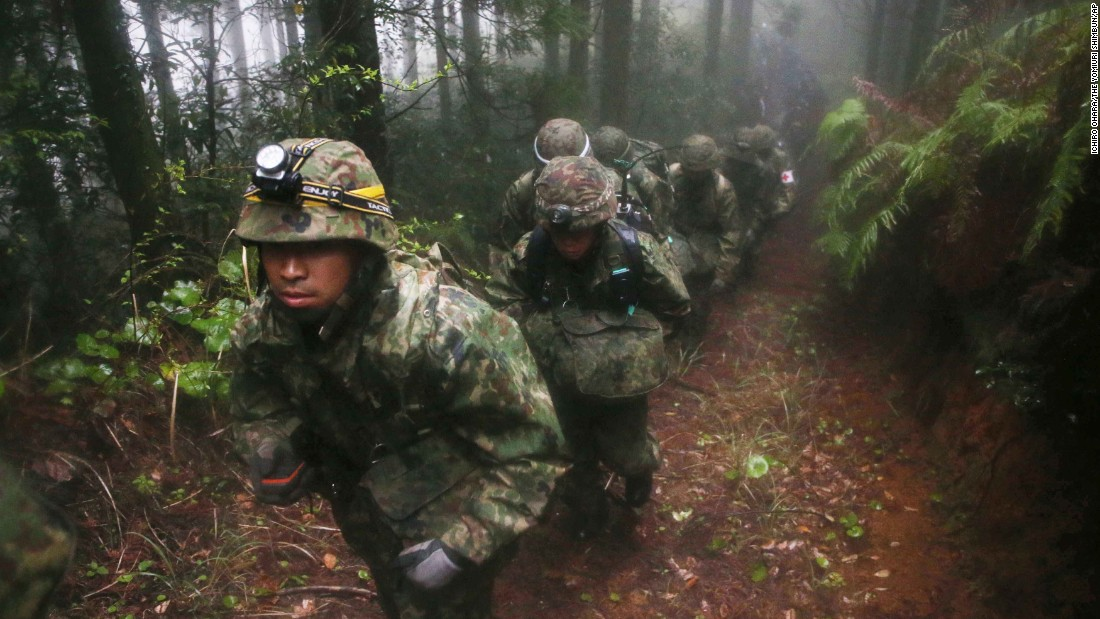 "Japanese troops climb a mountain Thursday, April 7, to search for a military jet that disappeared over the city of Kagoshima. At least four bodies have been found in the wreckage, <a href=""http://www.japantoday.com/category/national/view/wreckage-of-sdf-jet-found-on-kagoshima-mountain-6-feared-dead"" target=""_blank"">according to the Kyodo News Agency.</a>"