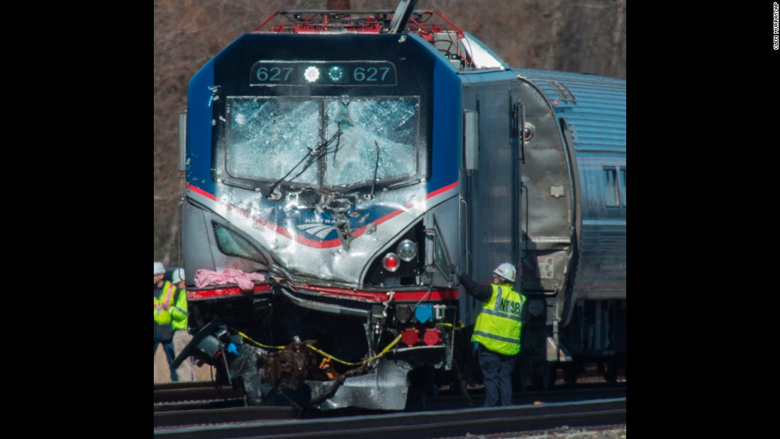 "Staff members of the National Transportation Safety Board inspect the engine of Amtrak Train 89, which <a href=""http://www.cnn.com/2016/04/04/us/amtrak-crash-philadelphia/"" target=""_blank"">crashed into a backhoe and derailed</a> in Chester, Pennsylvania, on Sunday, April 3. The crash killed two construction workers, a source close to the investigation said."