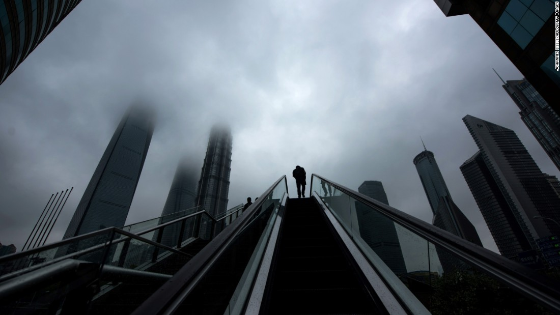 A man rides an escalator in the Lujiazui financial district of Shanghai, China, on Wednesday, April 6.