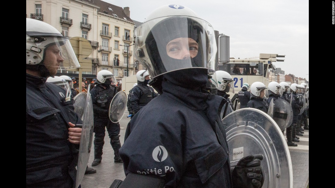Riot police secure a zone in the Molenbeek neighborhood of Brussels, Belgium, on Saturday, April 2. Belgian police officers and soldiers have fanned out across Brussels, arresting protesters who try to break a ban on demonstrations.
