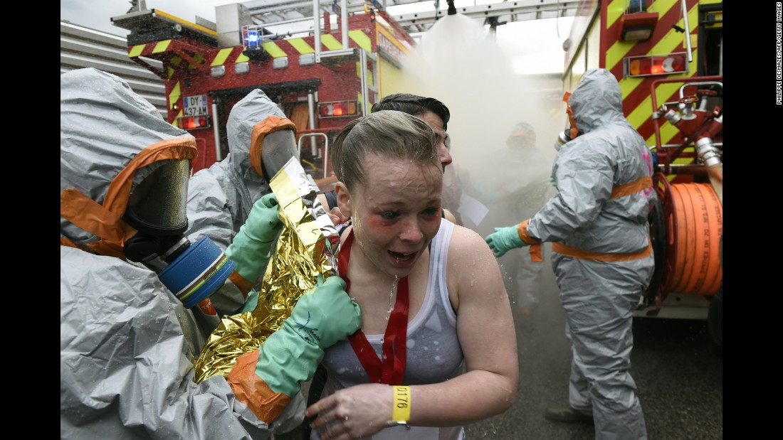 "Firefighters wearing chemical-protective clothing attend to ""victims"" during a mock chemical attack in Saint-Etienne, France, on Monday, April 4. The training exercise was part of security measures for Euro 2016, an international soccer tournament France is hosting this summer."