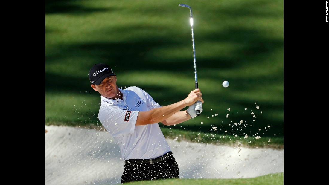 Jimmy Walker plays a sand shot on the 10th.