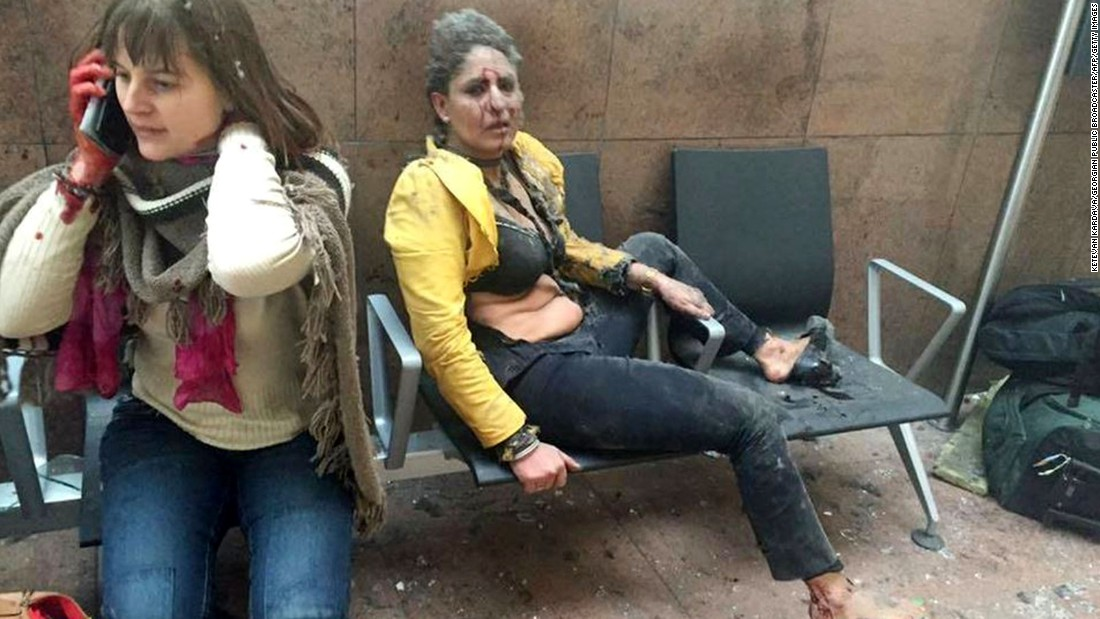 "Two wounded women sit in the airport in Brussels, Belgium, after two explosions rocked the facility on March 22, 2016. A subway station in the city <a href=""http://www.cnn.com/2016/03/24/europe/brussels-investigation/index.html"" target=""_blank"">was also targeted in terrorist attacks</a> that killed at least 30 people and injured hundreds more. Investigators say the suspects belonged to the same ISIS network that was behind the Paris terror attacks in November."