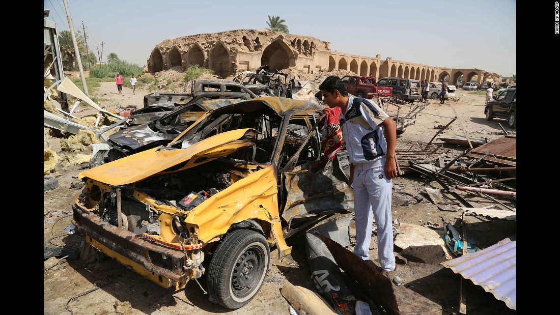 "A man inspects the aftermath of a car bombing in Khan Bani Saad, Iraq, on July 18, 2015. <a href=""http://www.cnn.com/2015/07/18/middleeast/iraq-violence/"" target=""_blank"">A suicide bomber with an ice truck,</a> promising cheap relief from the scorching summer heat, lured more than 100 people to their deaths. ISIS claimed responsibility on Twitter."