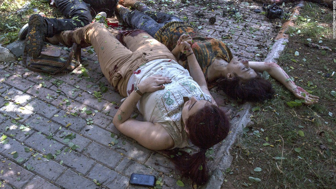 "Two women hold hands after an explosion in Suruc, Turkey, on July 20, 2015. The blast <a href=""http://www.cnn.com/2015/07/22/world/turkey-suruc-explosion/index.html"" target=""_blank"">occurred at the Amara Cultural Park,</a> where a group was calling for help to rebuild the Syrian city of Kobani, CNN Turk reported. At least 32 people were killed and at least 100 were wounded in the bombing. Turkish authorities said they believed ISIS was involved in the explosion."