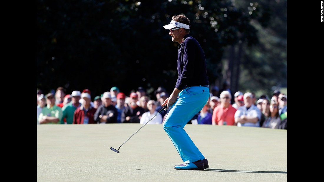 Ian Poulter reacts after missing a putt on the first hole on Friday.