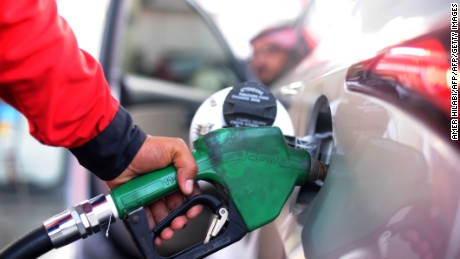 A Saudi employee fills the tank of his car with petrol at a station on December 28, 2015 in the Red Sea city of Jeddah. Saudi Arabia said it plans to review the prices of heavily-subsidised power and fuel as part of new measures introduced in the face of low oil prices.   AFP PHOTO / AMER HILABI / AFP / AMER HILABI        (Photo credit should read AMER HILABI/AFP/Getty Images)