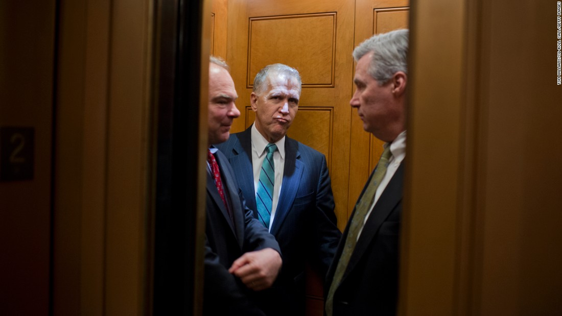 From left, U.S. Sens. Tim Kaine, Thom Tillis and Sheldon Whitehouse board an elevator after a vote in Washington on Thursday, April 7.