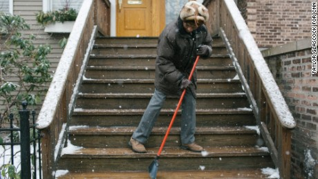 Hopkins clears the steps to his Victorian townhouse on a wintry Chicago day. He moved  to the Windy City to be closer to family.
