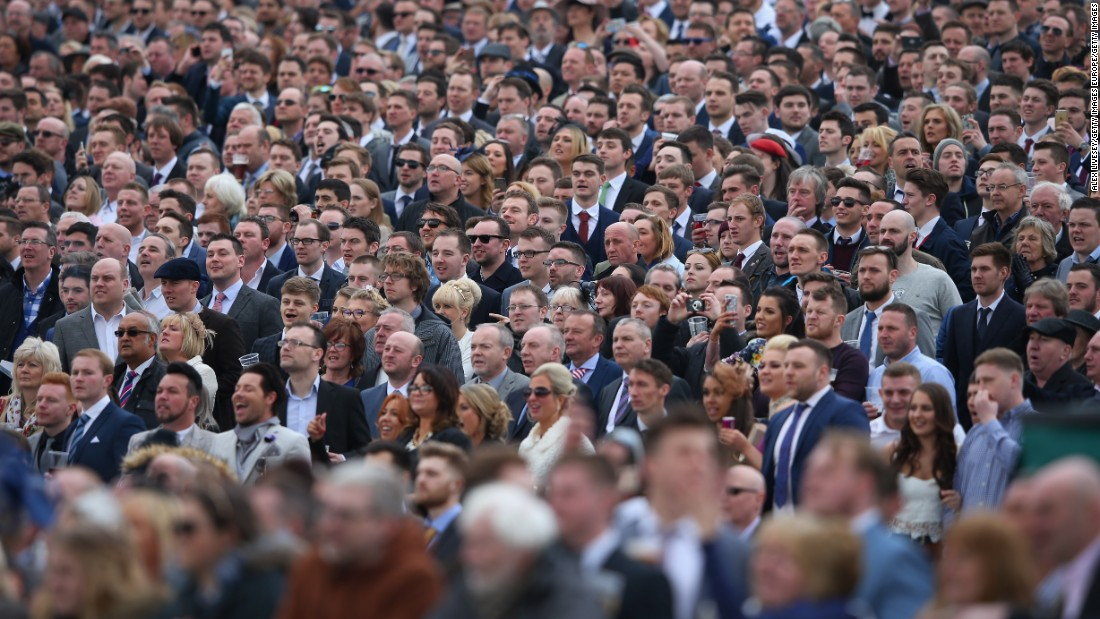 Fans look on engrossed by the action at the Aintree race course.