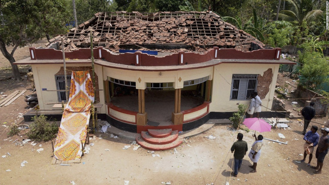 Extensive damage is visible on a building in the Puttingal temple complex.